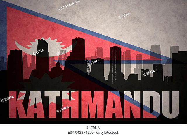 abstract silhouette of the city with text Kathmandu at the vintage nepal flag background
