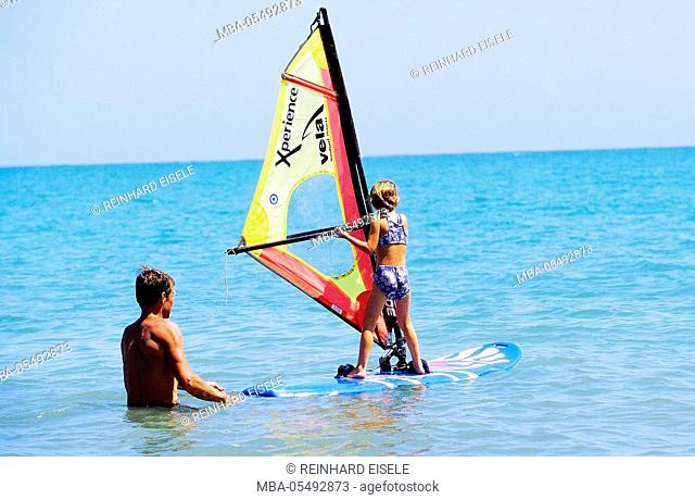 Father learns child windsurfing