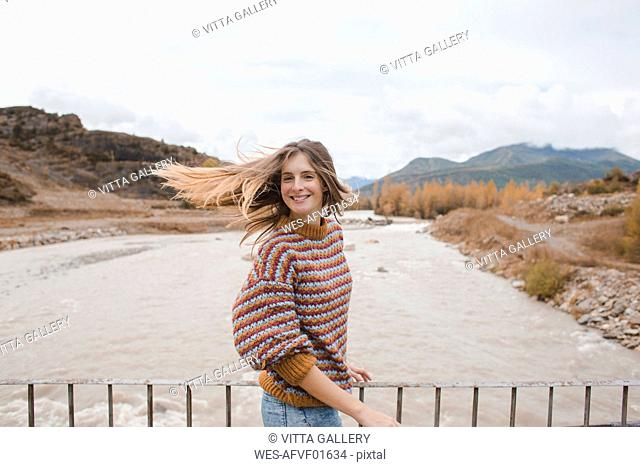 Spain, portrait of happy young woman in Ordesa National Park