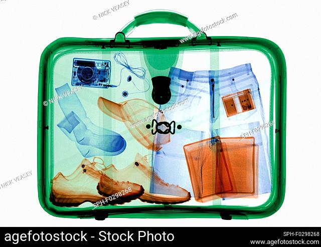 Suitcase packed with clothing, X-ray