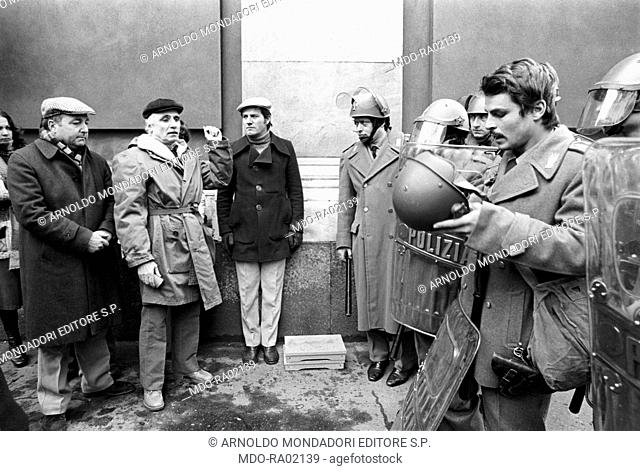 Italian director Mario Monicelli giving some directions to Italian actor, director and scriptwriter Michele Placido on the set of the film Come Home and Meet My...