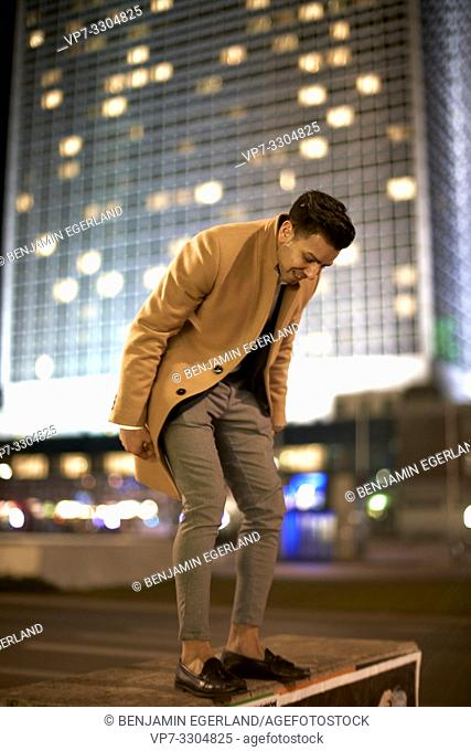 young man at night, in Berlin, Germany