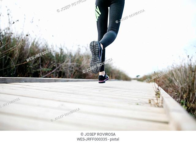 Spain, Tarragona, Woman running on a catwalk