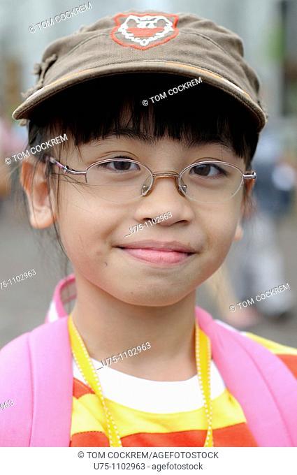 girl outside basilica minore del santo nino cebu city philippines