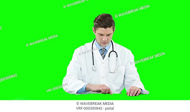 Male doctor using digital screen