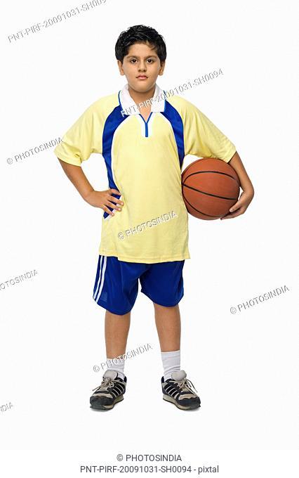 Portrait of a boy holding a basketball