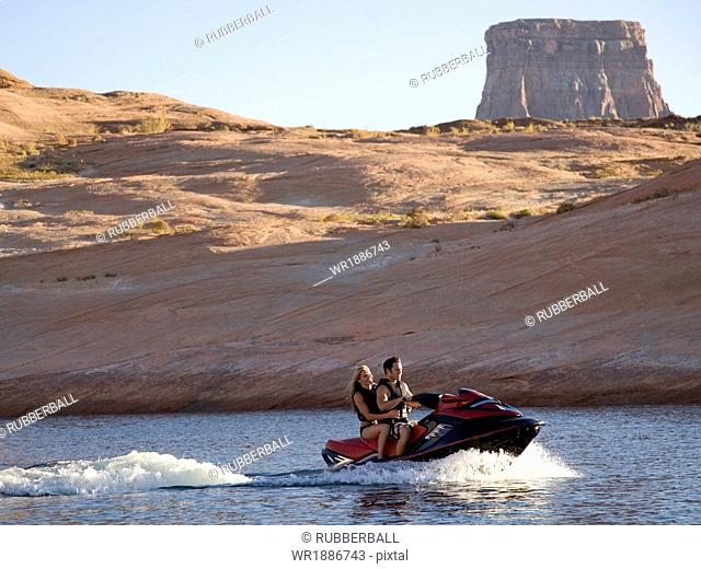 young couple on a jet ski at lake powell
