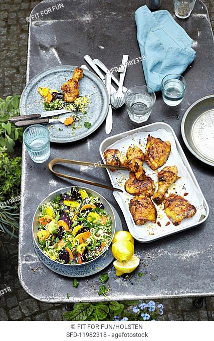 Grilled chicken legs in buttermilk marinade and couscous with colourful carrots