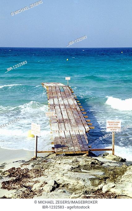 Jetty on the beach, Platja de ses Illetes beach, Playa Trucadors, Illa de Formentera island, Balearic Islands, Spain, Europe