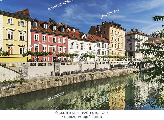 View over the river Ljubljanica to the promenade and to the historic houses of the old town of Ljubljana, Slovenia, Europe