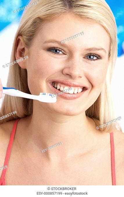Young Woman Brushing Teeth In Studio