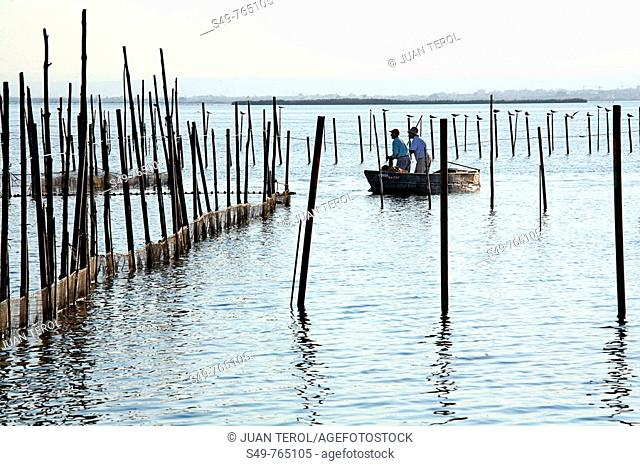 Given two fishermen fishing in the waters of La Albufera of Valencia