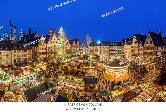 Germany, Frankfurt, Christmas market at Roemerberg in the evening seen from above