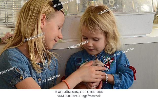 Two girls with a hamster