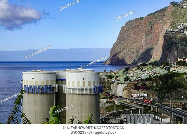 Funchal, Madeira, Portugal The coastline and cement silos at a construiction site