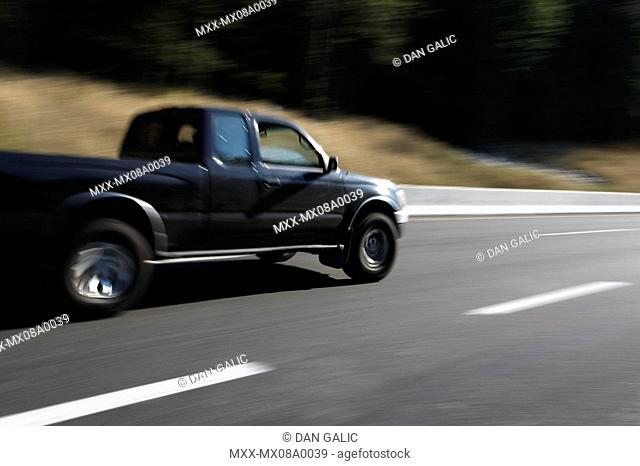 Speeding pickup truck on hwy 99 sea to sky highway, Squamish, British Columbia, Canada