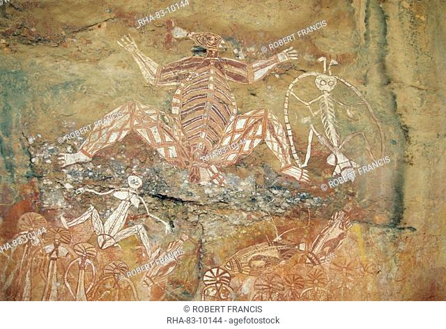 Namondjok centre who ate his clan sister, Namarrgon right , the Lightning Man and Barrginj his wife below left supernatural ancestors at the rock art site at...
