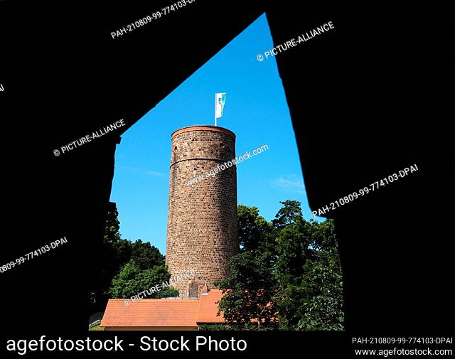26 July 2021, Brandenburg, Bad Belzig: The tower of Eisenhardt Castle. The well-preserved castle complex on the outskirts of the town is a landmark visible from...