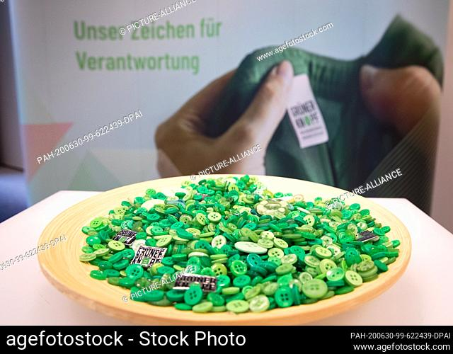 """30 June 2020, Hamburg: Green Buttons in a bowl at a press conference on the textile label """"""""Green Button"""""""" with Federal Development Minister Müller at the..."""