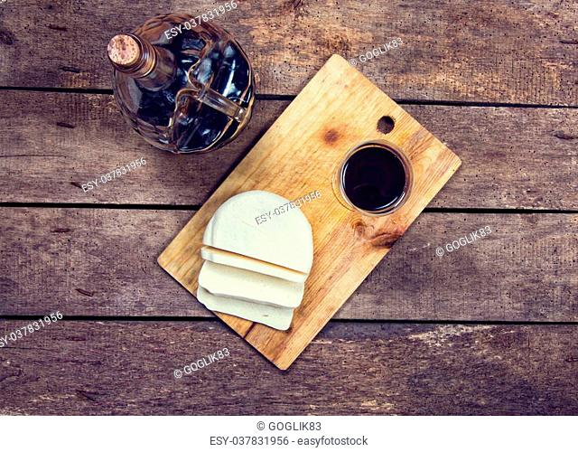 wine and cheese on wooden table
