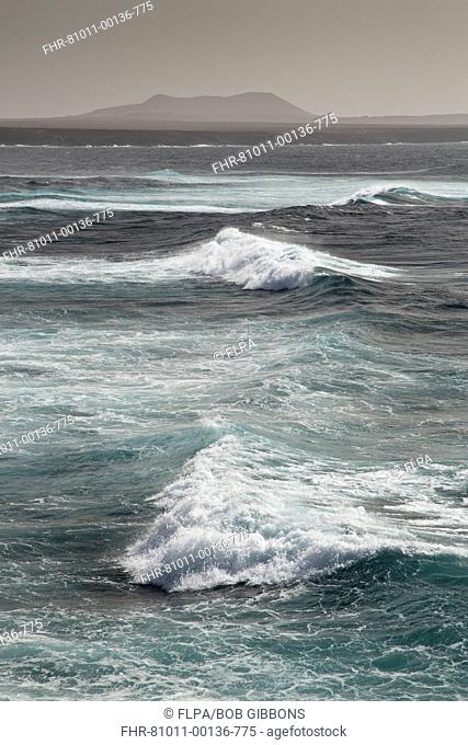View of waves at coast, with Montana Roja in distance, Playa de Janubio, Lanzarote, Canary Islands, March