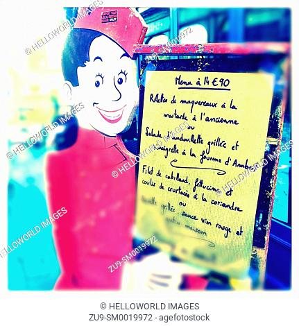 Smiling figure holding set menu in French, Clermont Ferrand, Auvergne, France, Europe