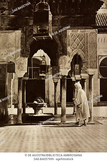 Believers at the ablution fountain in the Kairaouine Mosque, Fes, Morocco, photograph from the magazine L'Illustration, year 75, no 3902, December 15, 1917