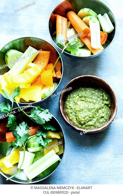 Bowl of dill pesto served with vegetables