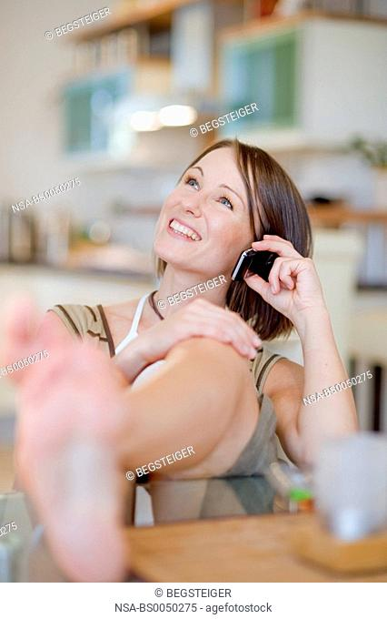 young woman at home with mobile phone
