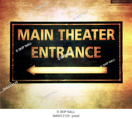 A sign pointing the way to a theater entrance