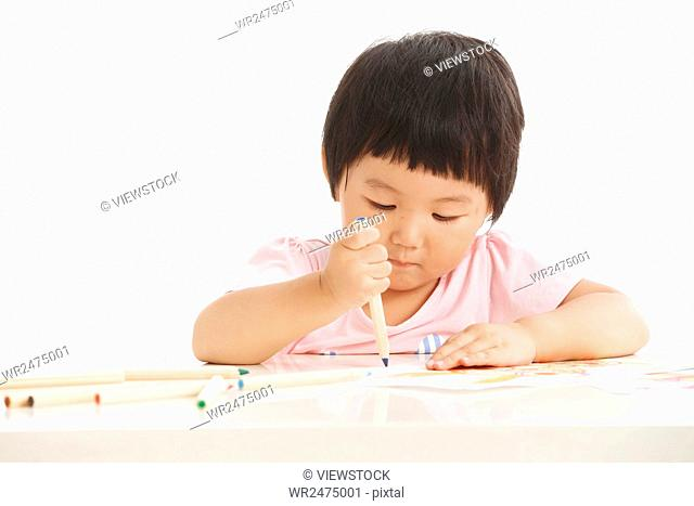 The little girl is writing
