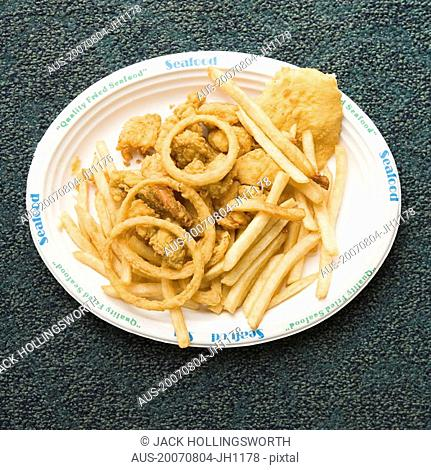 Close-up of a plate of snacks on a carpet