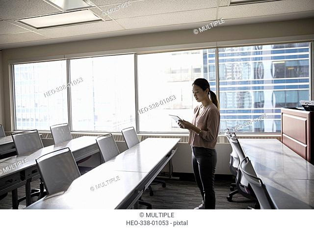 Businesswoman using digital tablet in office classroom