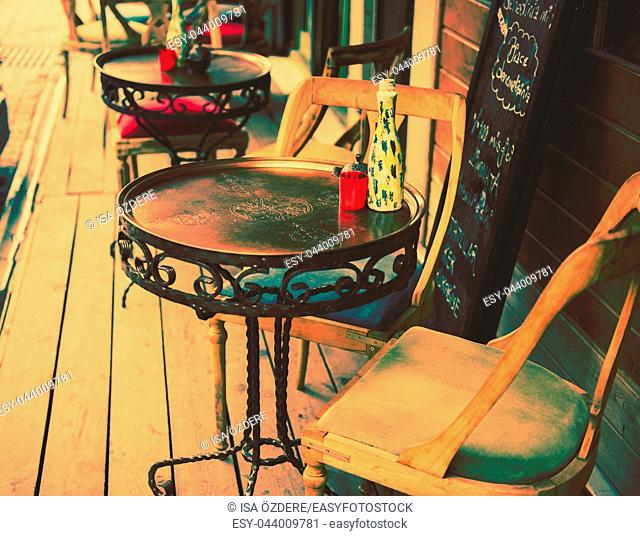 Retro, vintage view of Pastel coffee shop with metallic tables and chairs in Balat, old town of Istanbul, Turkey. Outdoor cafe