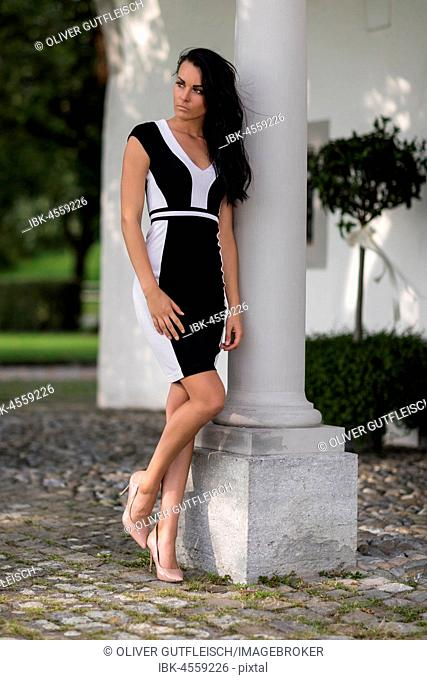 Woman with black and white elegant dress