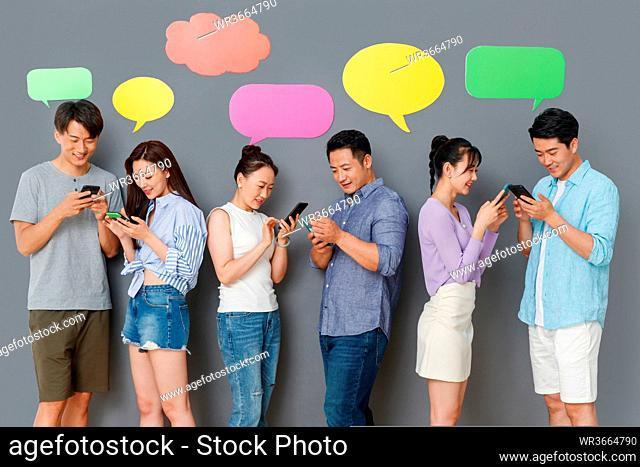 Happy couples use mobile phone chat software to communicate