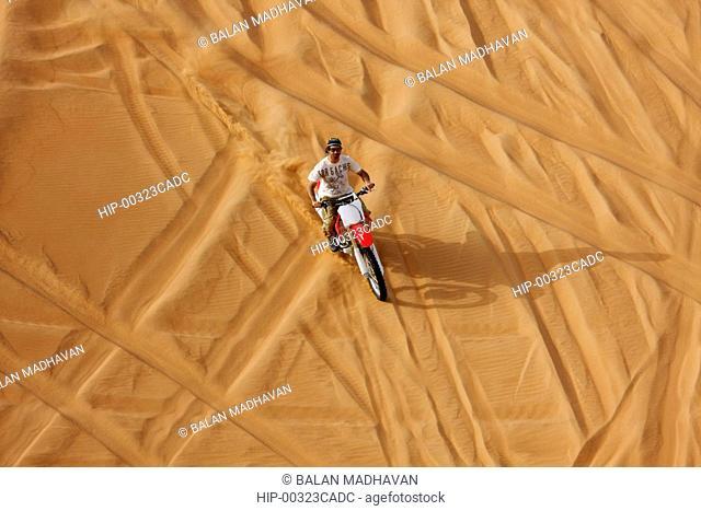 A DIRT BIKE AT THE DESERT SAFARI IN DUBAI