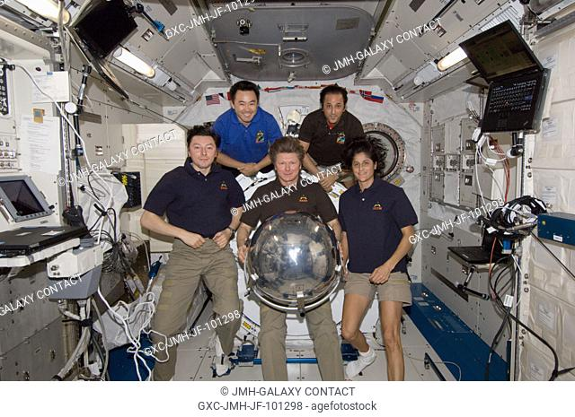 Five of the six Expedition 32 crew members pose for a photo with a small ball-shaped science satellite in the Kibo laboratory of the International Space Station