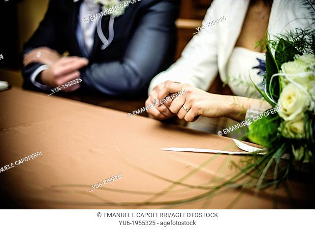 Hands of the newlyweds nervous
