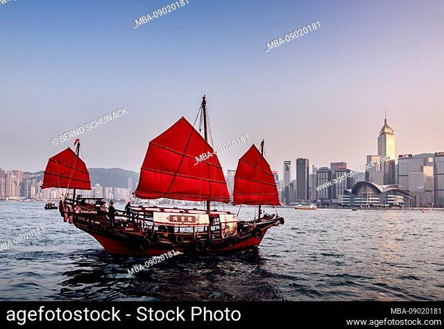 Tour boat in Hong Kong harbor at sunset