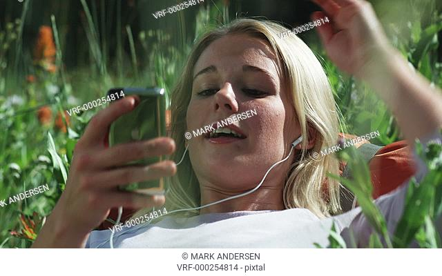 woman listening to iPod outdoors