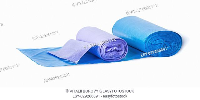 Blue and violet rolls of plastic garbage bags isolated on white background
