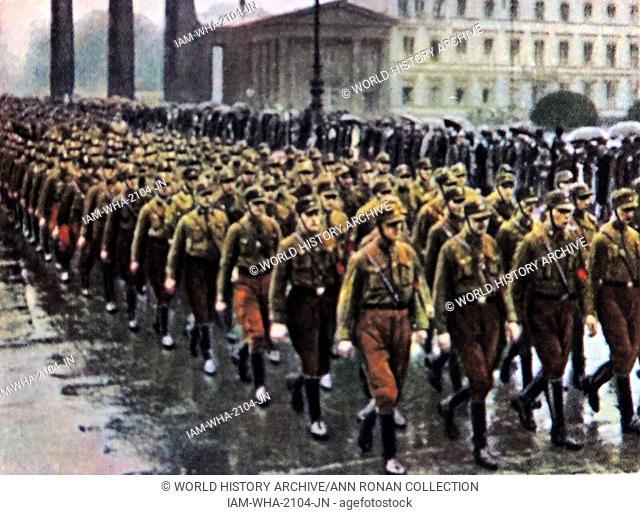 Nazi SA brownshirts march through the Brandenburg Gate in Berlin, Germany circa 1933