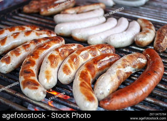 Sausages or brattwurst on display in a Christmas market in central Berlin, Germany