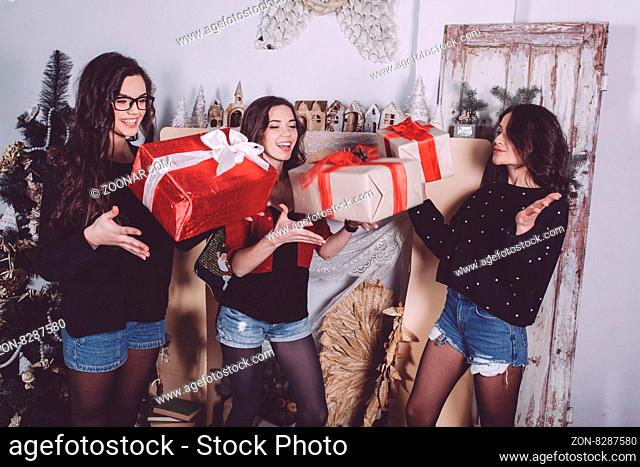 Beautiful girl throw up Christmas gifts. Decorative vintage apartment. cookies