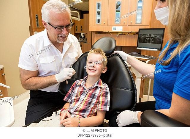 A young boy at a dental examination; Edmonton, Alberta, Canada