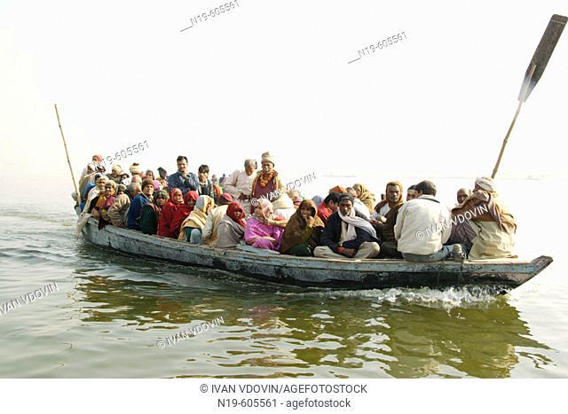 Boat with people on Ganges (Ganga), Varanasi (Benares, Benaras, Banaras), Hindu holy city, state Uttar Pradesh, India