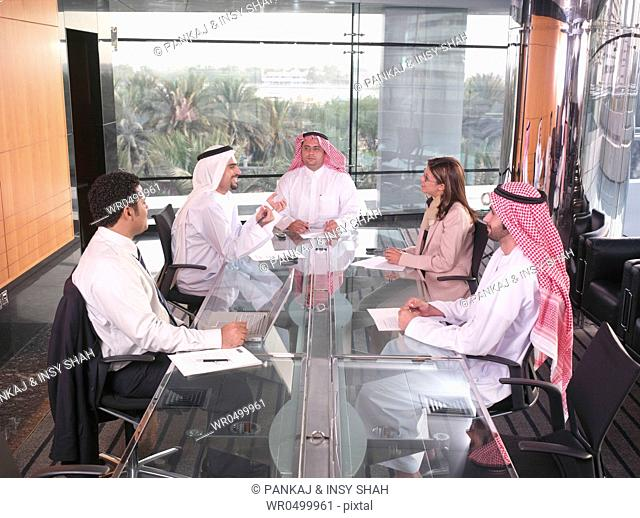 Small group of Business persons in a discussion