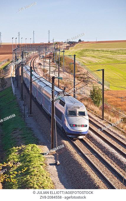 A TGV speeds through the Burgundy countryside of France