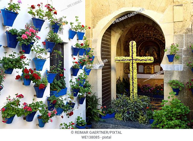 Our lady of Bethlehem and Shepherds Chapel with flower pots in courtyard during Spring festival Cordoba